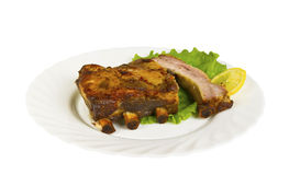 The ribs of wild boar grill on the plate, isolated Stock Photography