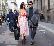 MILAN - FEBRUARY 24, 2018: Riccardo Pozzoli and Gabrielle Caunesil walking in the street after ERMANNO SCERVINO fashion show, duri. Riccardo Pozzoli and Royalty Free Stock Images