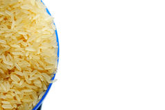 Rice. Blue saucer with rise isolated against white background stock photo