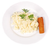 Rice. On a white plate with a plain background Stock Photography