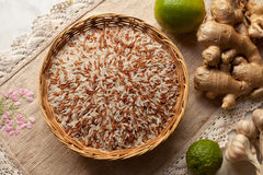 Rice. Raw rice in wooden basket Stock Photography