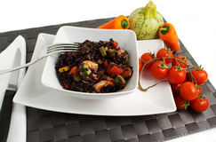 Rice. Black rice on a white background Royalty Free Stock Photography