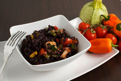 Rice. Black rice on te table with vegetables Stock Images