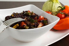 Rice. Black rice on te table with vegetables Stock Image