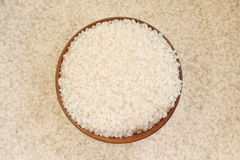 Rice. Macro background of white rice and bowl Stock Photo