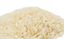 Rice. Close-up of rice isolated on white background Royalty Free Stock Image