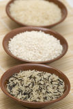 Rice. Three cuos with various shapes of rice Royalty Free Stock Images