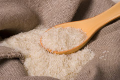 Rice. Cereals, white rice in sack and spoon Royalty Free Stock Photos