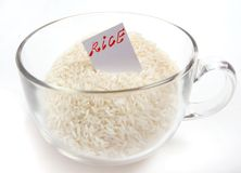 Rice. In glass cup with label royalty free stock photo