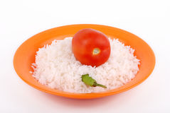 Rice. In plate with tomato and hot pepper Stock Image
