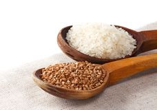 Rice And Buckwheat In Spoon Stock Photos