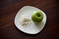 Rice and apple Stock Images