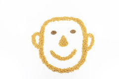 Rice is arranged into the shape shown to be happy. Jasmine rice is placed on a white background Royalty Free Stock Photography