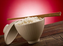 Rice with asian chopstick Stock Photos