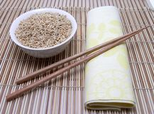 Rice and asian chopsticks stock photography