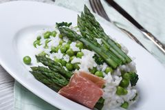 Rice with asparagus and green peas close-up Stock Image