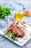 Rice with asparagus and meat. Boiled rice with meat and green asparagus royalty free stock images