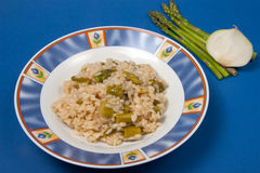 Rice with asparagus. And onion dish of Italian cuisine Stock Images