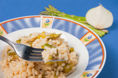 Rice with asparagus. And onion dish of Italian cuisine Stock Photos