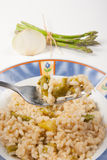 Rice with asparagus. And onion dish of Italian cuisine Stock Image