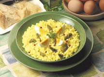Rice with asparagus. Saffron in green plate Stock Photography