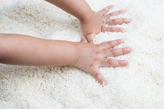 Rice with baby hands. White rice with baby hands Royalty Free Stock Photo