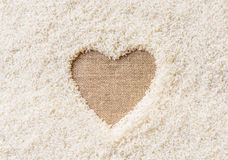 Rice background Space in the middle of a heart Stock Photography
