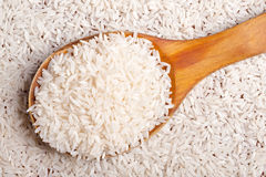 Rice background with spoon. Stock Photography