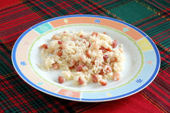 Rice with bacon. Portion of rice topped with bacon Royalty Free Stock Images