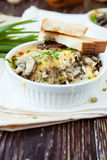 Rice baked with cheese and mushrooms Stock Photo