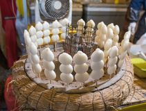 Rice ball dango grill. Rice ball  dango  stick  charcoal grill put in hay Stock Photography