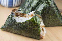 Rice ball (onigiri) with bite mark. Japanese food royalty free stock image