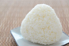 Rice ball. A plate of rice ball on a bamboo mat stock photo