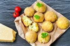 Home made    rice italian style  Croquette. Rice balls or croquette ,, parmesan cheese and cherry tomatoes Royalty Free Stock Images