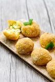 Home made    rice italian style  Croquette.Arancini. Rice balls or croquette  with parmesan cheese Royalty Free Stock Images