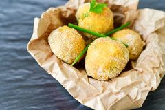 Home made    rice italian style  Croquette.Arancini. Rice balls or croquette  with parmesan cheese and italian bread stick taralli Royalty Free Stock Photography