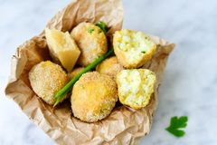Home made    rice italian style  Croquette.Arancini. Rice balls or croquette  with parmesan cheese and italian bread stick taralli Royalty Free Stock Photo