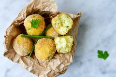 Home made    rice italian style  Croquette.Arancini. Rice balls or croquette  with parmesan cheese and italian bread stick taralli Stock Photo