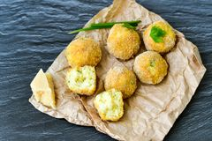 Home made    rice italian style  Croquette.Arancini. Rice balls or croquette  with parmesan cheese and italian bread stick taralli Royalty Free Stock Photos
