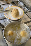 Rice balls frying in boiling oil. Rice balls frying immersed in boiling oil Stock Photo