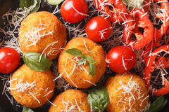 Rice balls and salad of fresh vegetables macro. horizontal top v Royalty Free Stock Images
