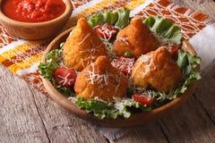 Rice balls stuffed with meat and tomato sauce closeup. horizonta Royalty Free Stock Photo