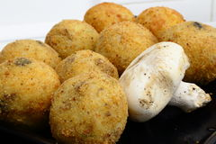 Rice balls. Typical Sicilian fried rice balls, can contain delicious ham and mozzarella or tomato sauce Stock Image
