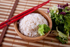 Rice in bamboo bowl with chopsticks Stock Photography