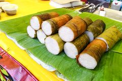 Rice bamboo or lemang is popular festive cusine in Malaysia. Sold at road side stalls during iftar or Muslim fasting month royalty free stock photography