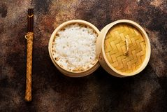 Rice in bamboo steamer with chopsticks Stock Image