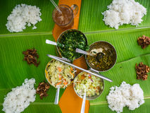 Rice and Banana Leaf Lunch. The beginning of a banana leaf lunch. Rice, vegetables and curry are beautifully presented Stock Photo