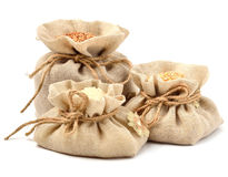 Rice, barley and buckwheat in cloth sacks Stock Images