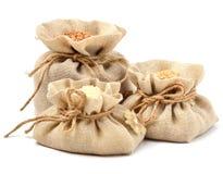 Rice, barley and buckwheat in cloth sacks Stock Images