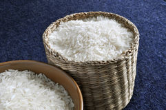 Rice in basket and bowl. Rice contained in a small basket and a bowl Royalty Free Stock Image